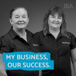 Two women side my side wearing shirts branded All Aspects, and the words My business our success